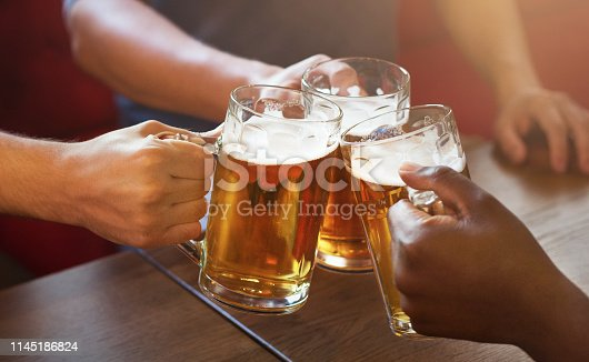 istock Friends toasting with glasses of light beer 1145186824