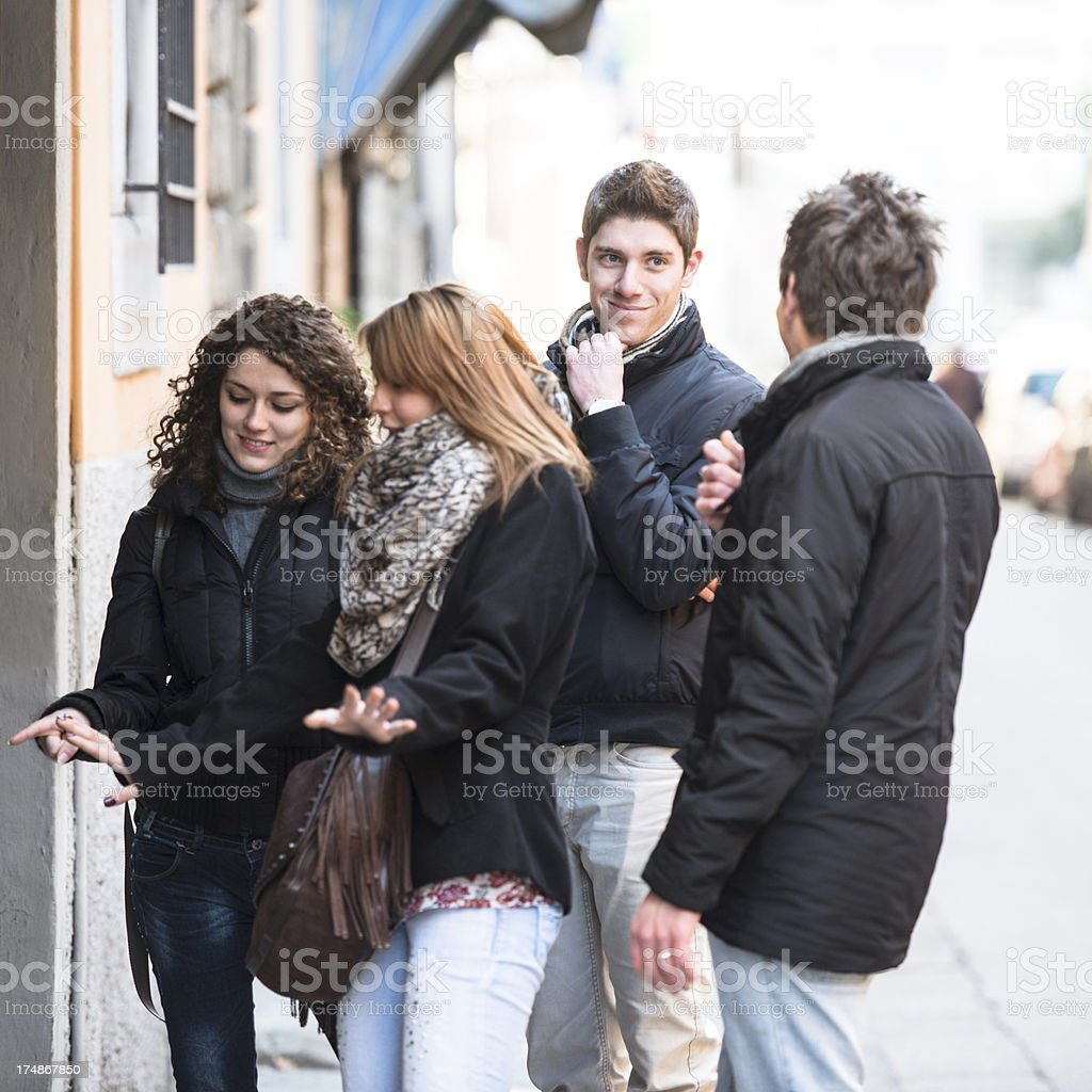 Friends togetherness looking the shops royalty-free stock photo