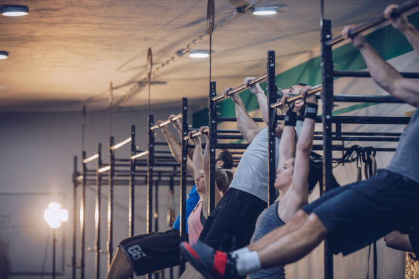 Friends training in gym all together stock photo