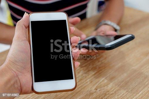 istock Friends transfering money through smartphone 971914562