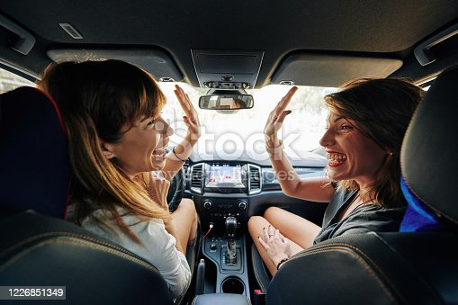 907987862 istock photo Friends traveling by car 1226851349