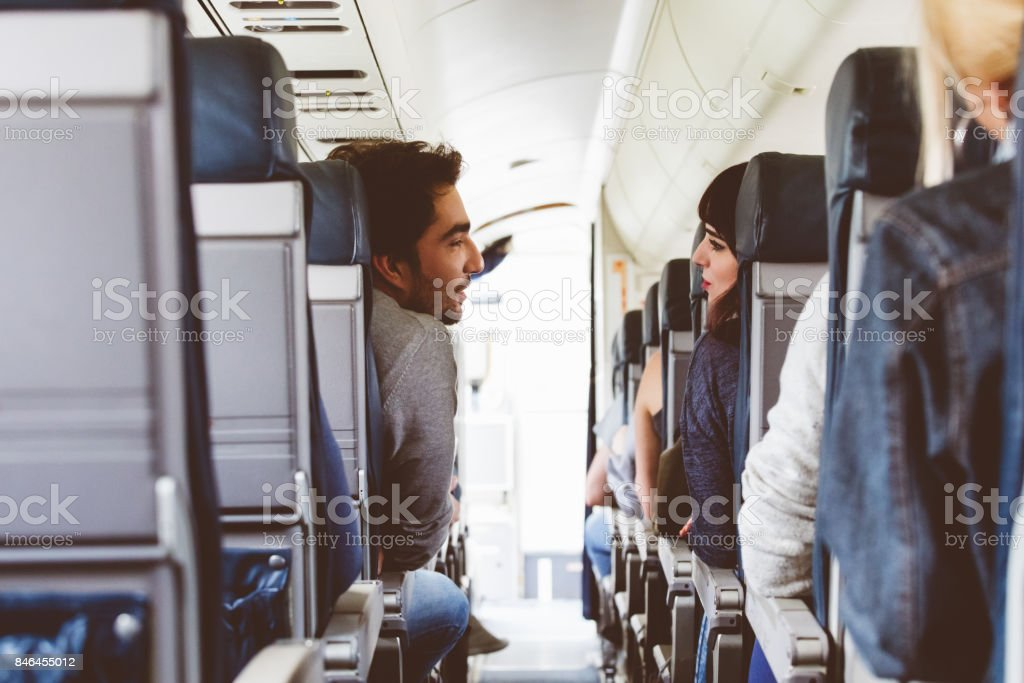 Friends traveling by flight stock photo