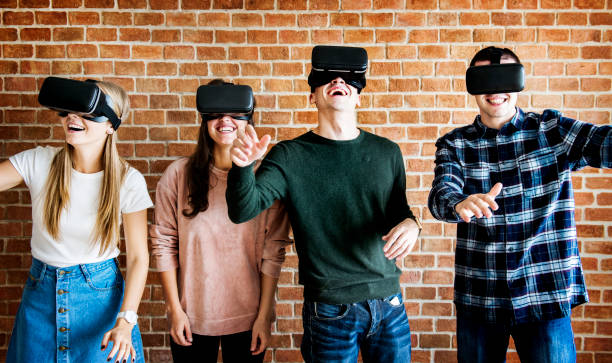 Friends trying on VR headsets Friends trying on VR headsets generation z stock pictures, royalty-free photos & images