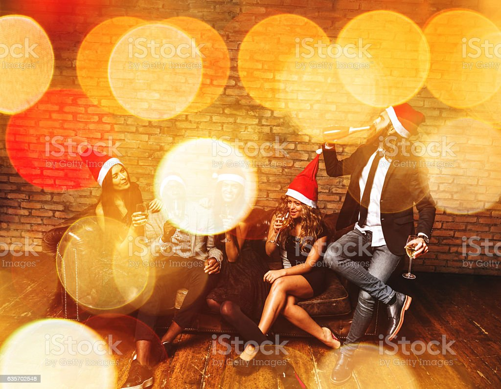 friends using a sparkler togetherness for christmas royalty-free stock photo