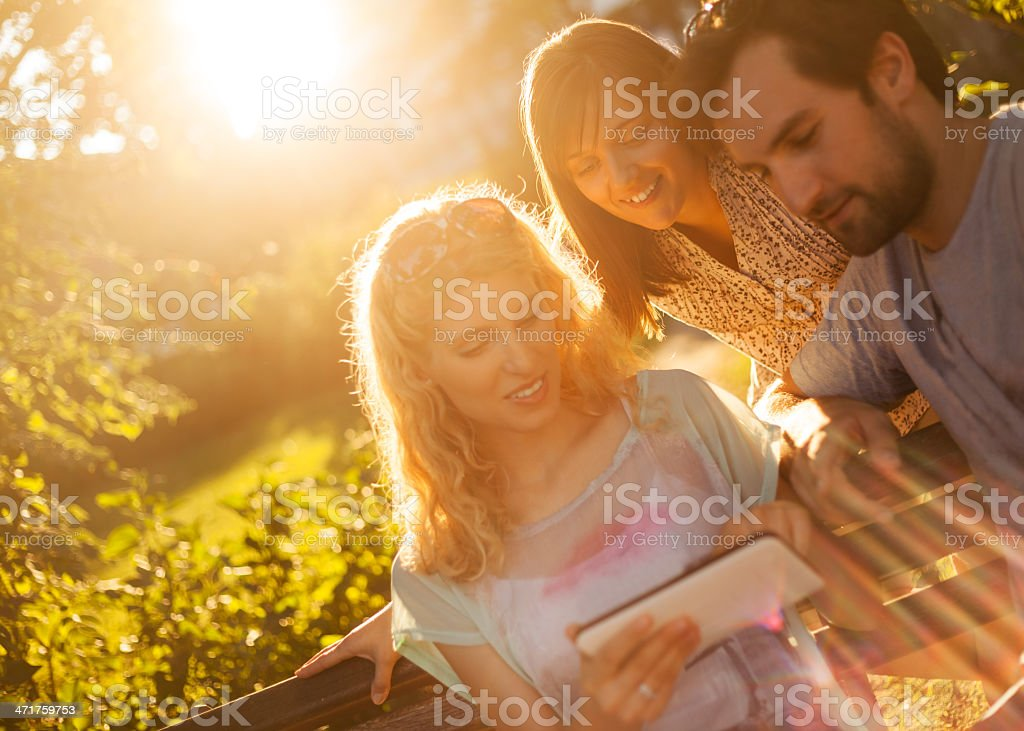 Friends using digital tablet royalty-free stock photo