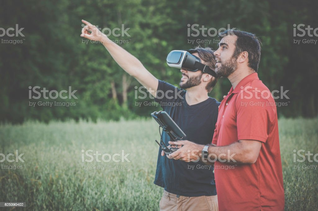 Friends Using Drone and Virtual Reality Headset Outdoor stock photo