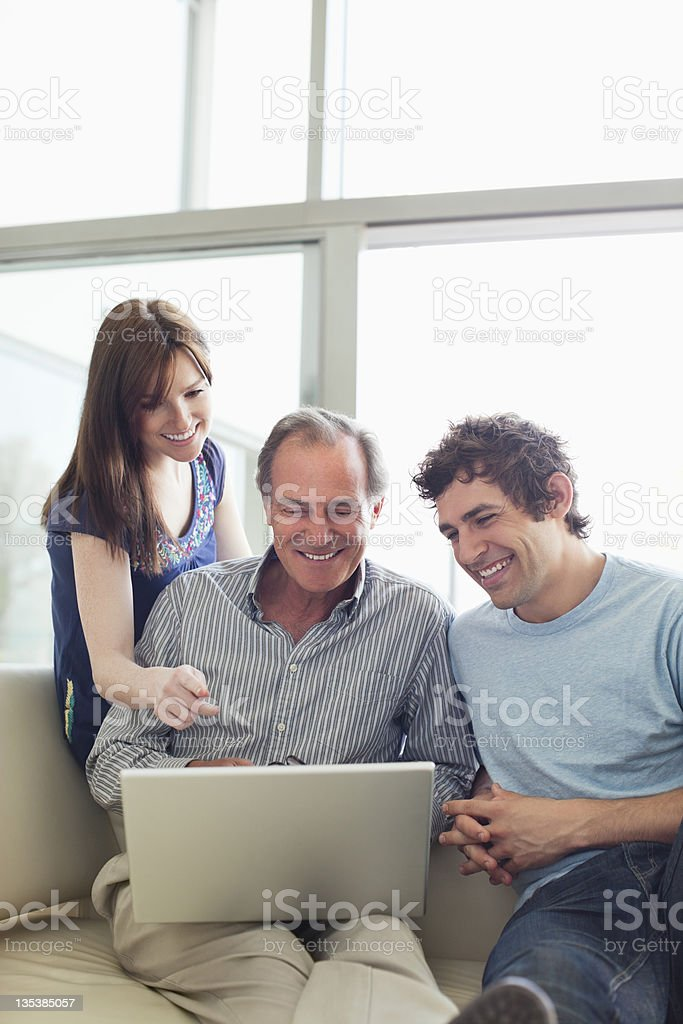 Friends using laptop together royalty-free stock photo