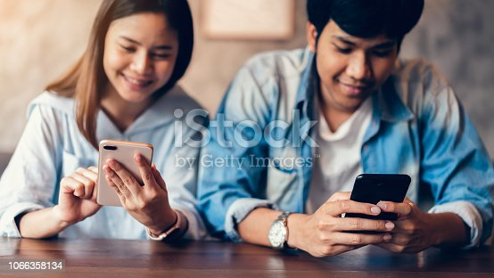 istock Friends using smartphone on cafe, During leisure time. The concept of using the phone is essential in everyday life. 1066358134