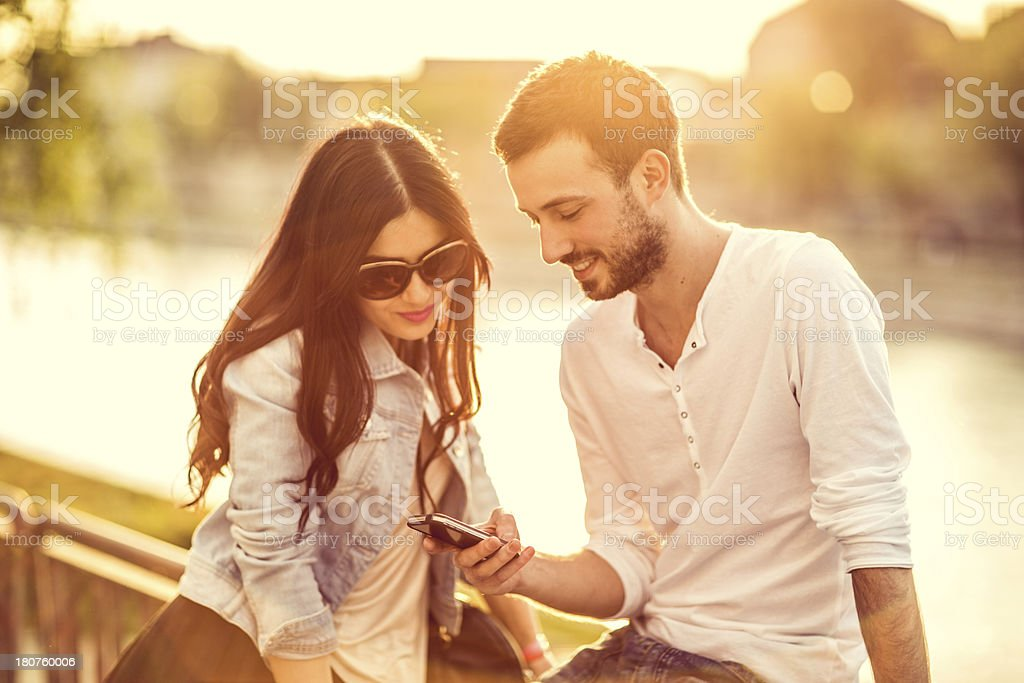Friends using smartphone royalty-free stock photo