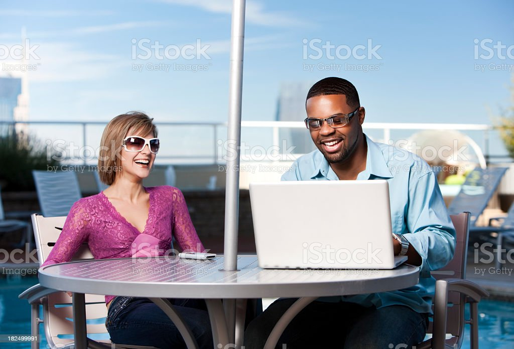 Friends Using Technology by the Pool royalty-free stock photo