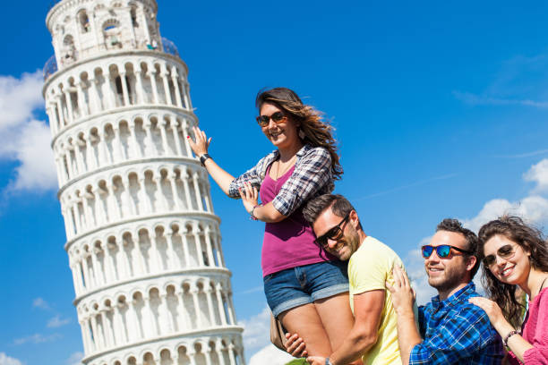 Friends visiting Italy - Pisa and the leaning tower stock photo