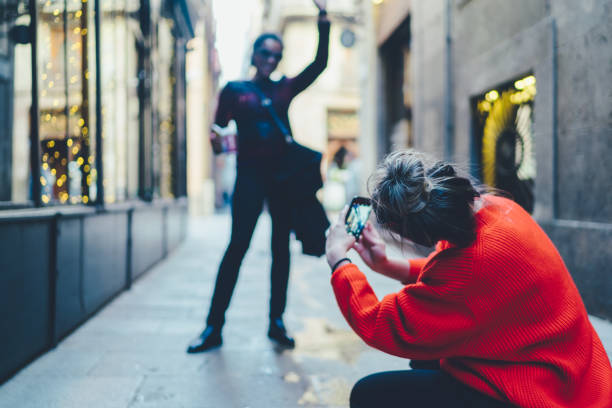 Friends visiting Spain Tourist women in Barcelona taking photos and exploring the city alternative pose stock pictures, royalty-free photos & images