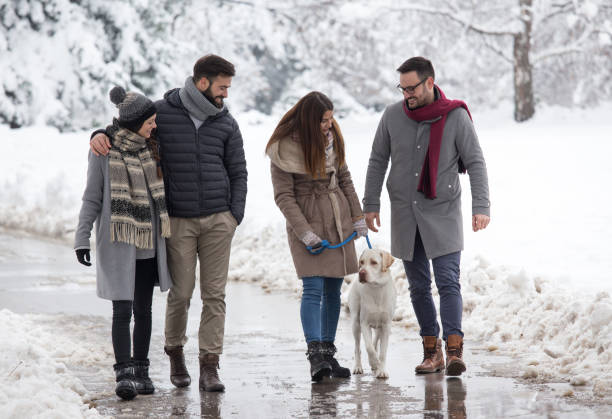 Friends walking dog on snow picture id1093246462?b=1&k=6&m=1093246462&s=612x612&w=0&h=q1lgteu3wvxkexkeqkvdmy63gjazabt3kz 5fdtnatw=