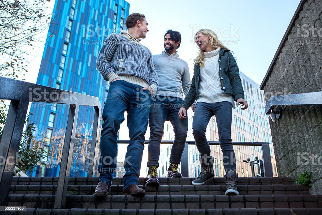 Friends Walking Down Stairs stock photo