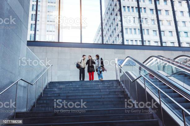 Friends walking down the steps of a building picture id1077788206?b=1&k=6&m=1077788206&s=612x612&h=rrmekbmzlos19a8gdjtk9 cepgy4ao8qvts 4 aypiw=