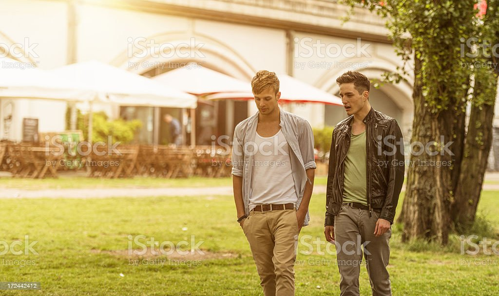 Friends walking in the park on berlin royalty-free stock photo