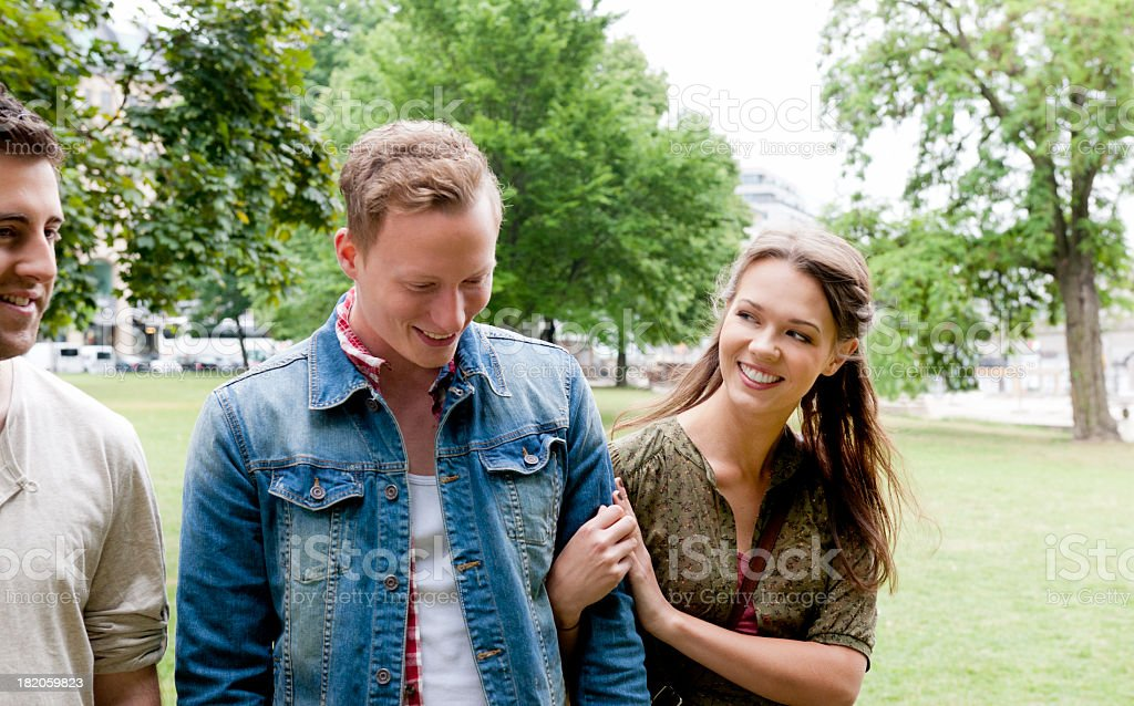 friends walking in the park royalty-free stock photo