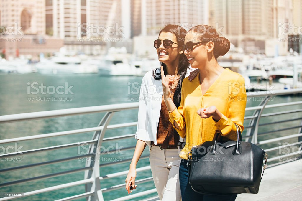 Friends walking outdoors stock photo