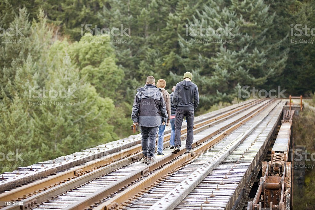 Friends Walking the Track stock photo