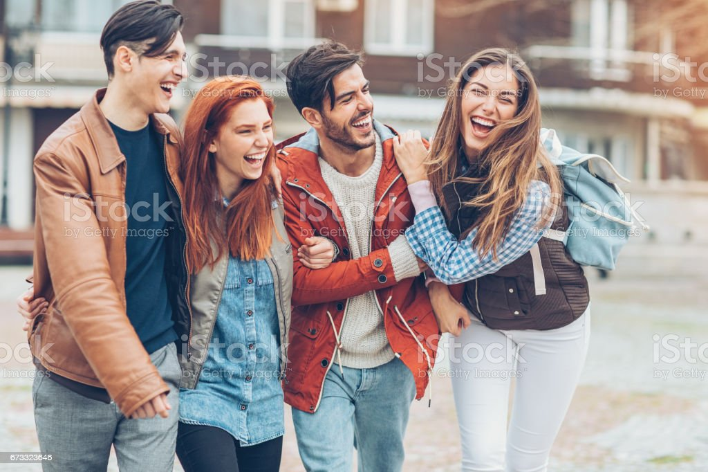 Friends walking together stock photo