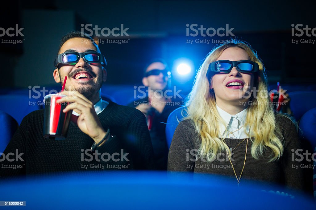 Friends watching 3d movie stock photo