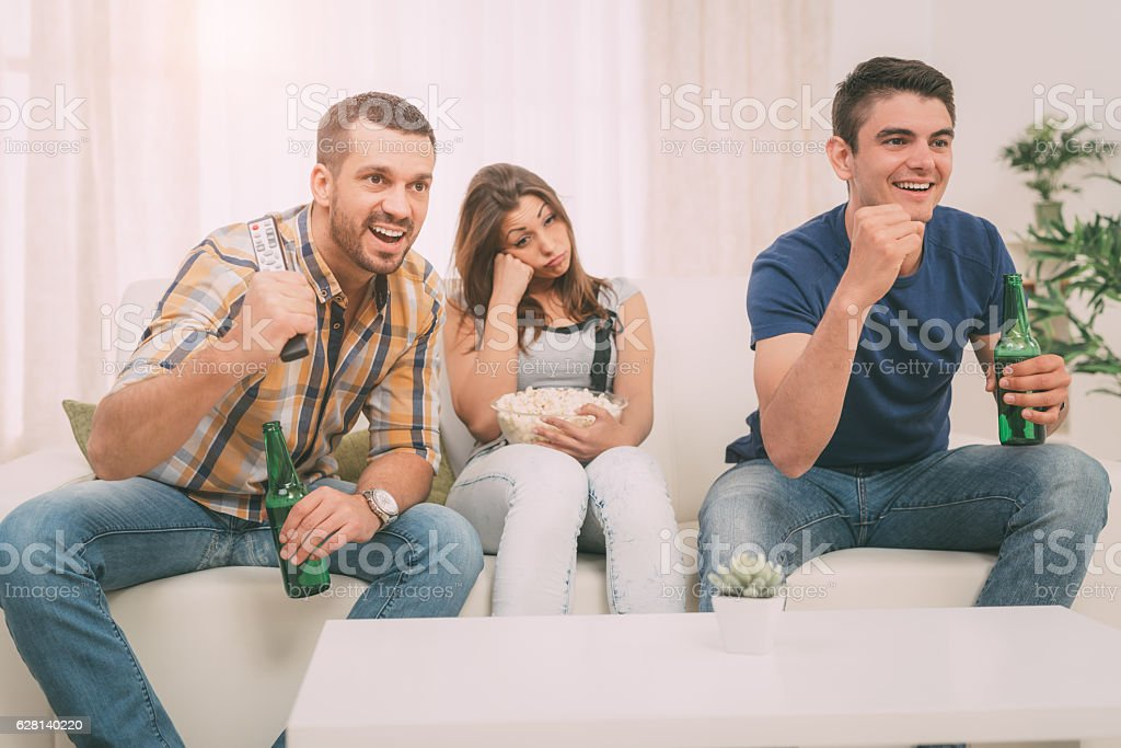 Friends Watching A Tv In The Home stock photo