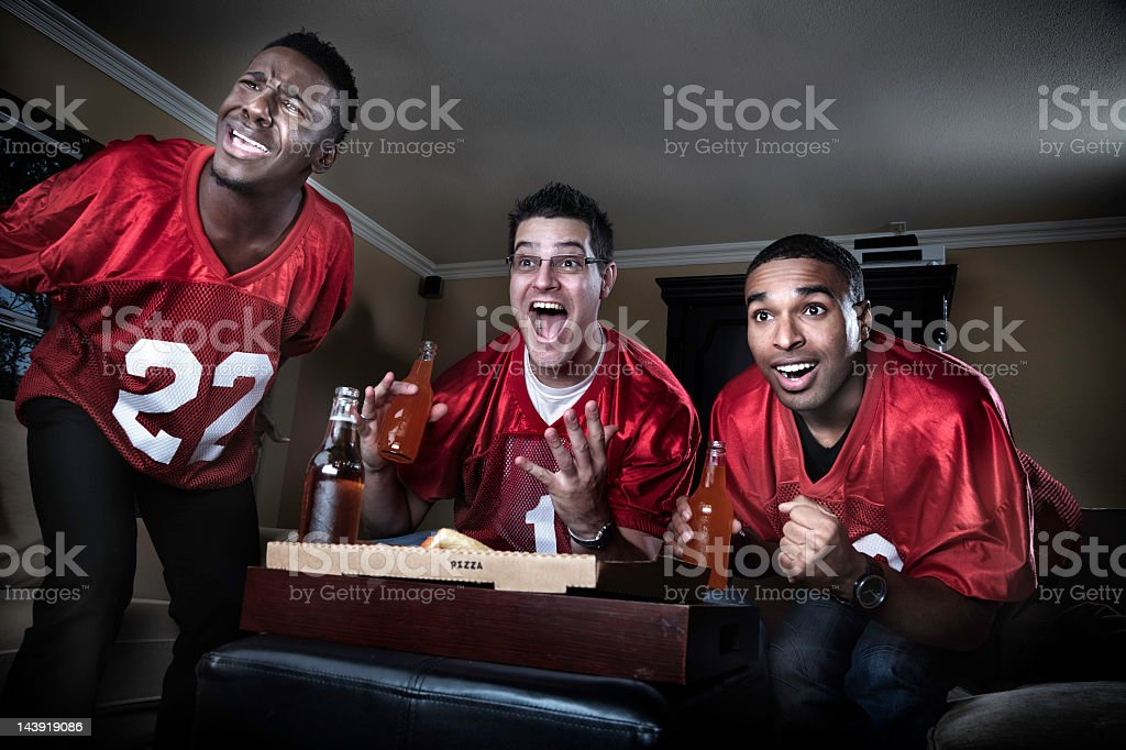 Friends watching Football on TV royalty-free stock photo