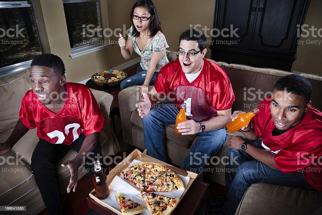 Friends Watching Football on TV stock photo
