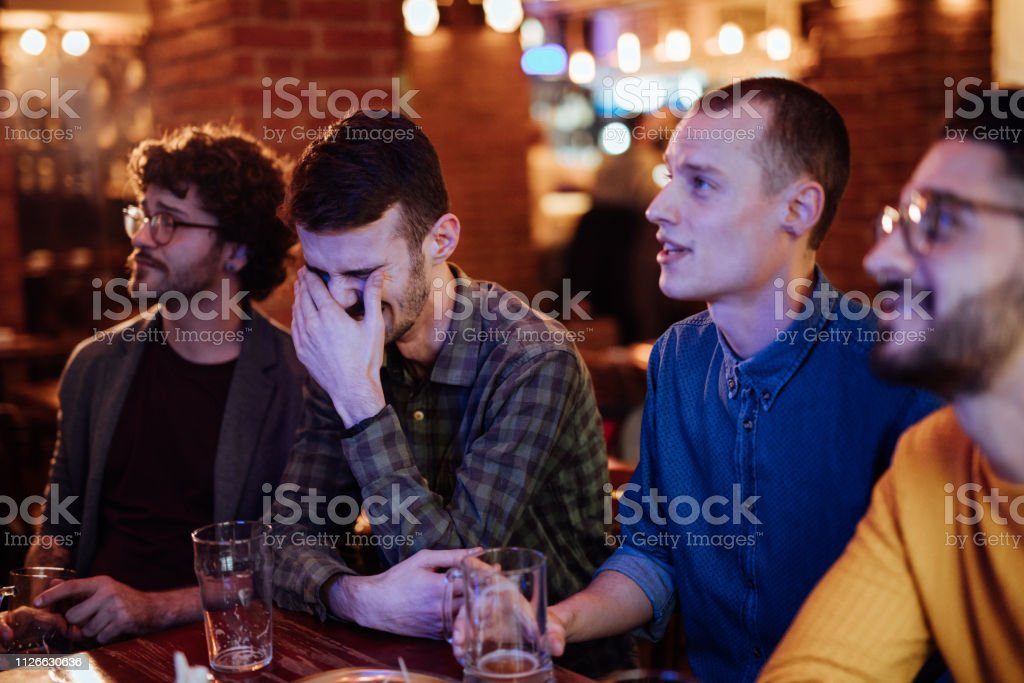 Friends Watching Game In Sports Bar
