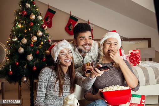 istock Friends watching movie and having fun at Christmas eve. 621704288