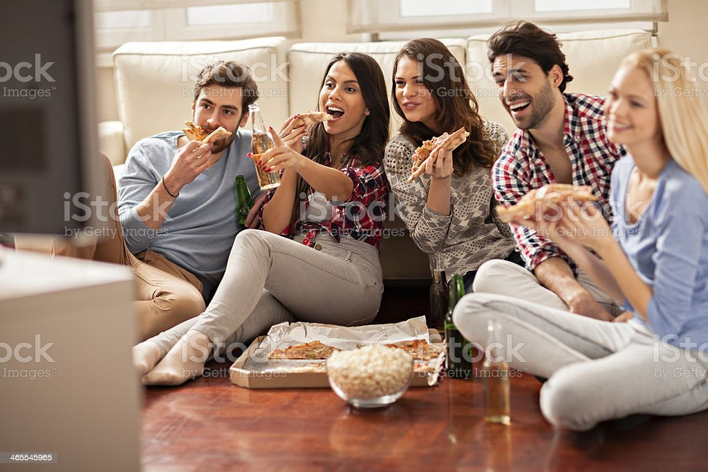 Friends watching movie royalty-free stock photo