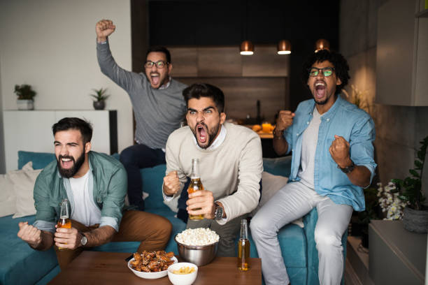 Friends watching sport on tv. stock photo