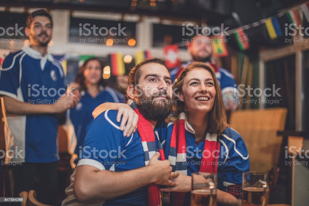 Friends watching sports game stock photo