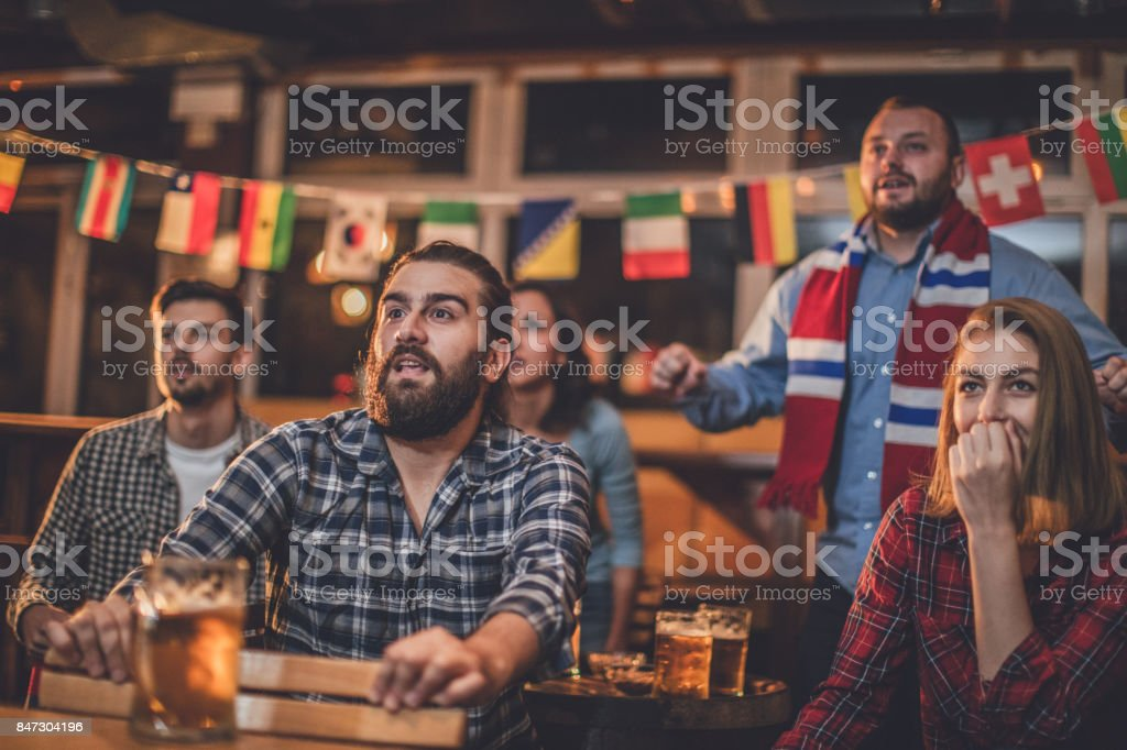 Friends watching the game stock photo