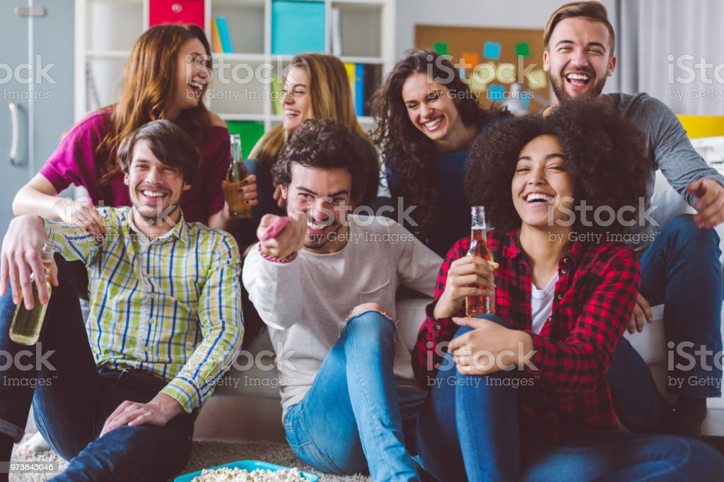 Friends watching tv in the classroom stock photo