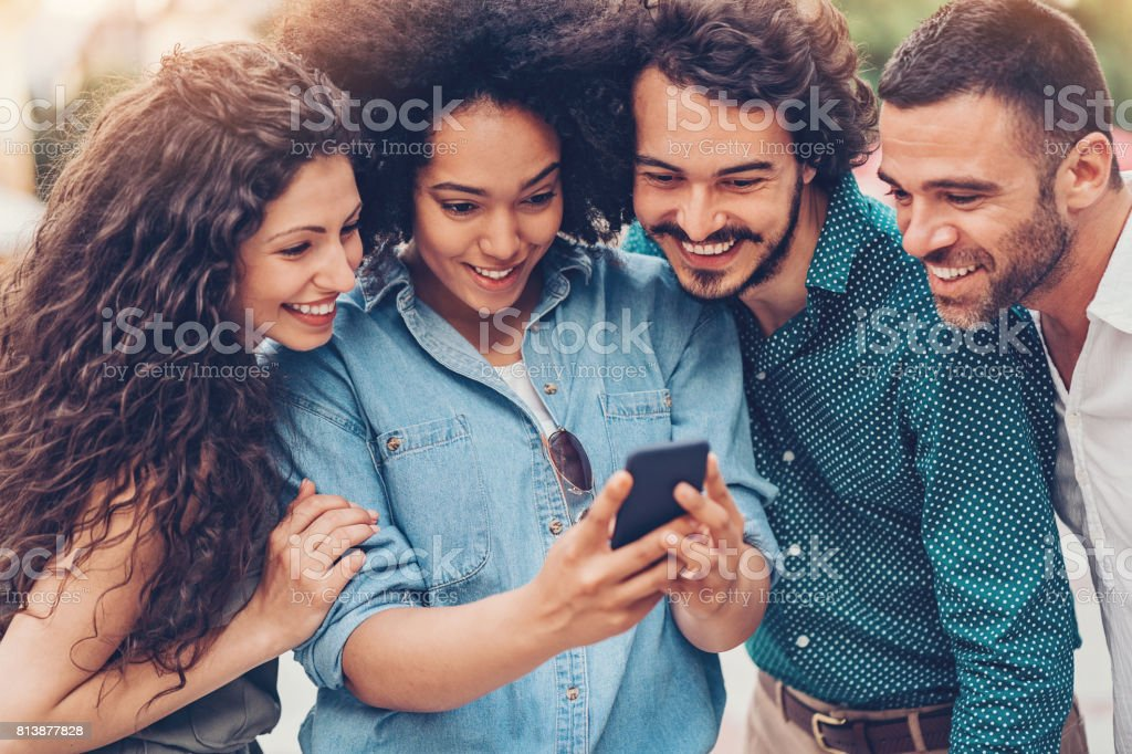 Friends watching video together stock photo