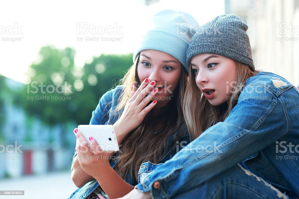 friends watching videos stock photo
