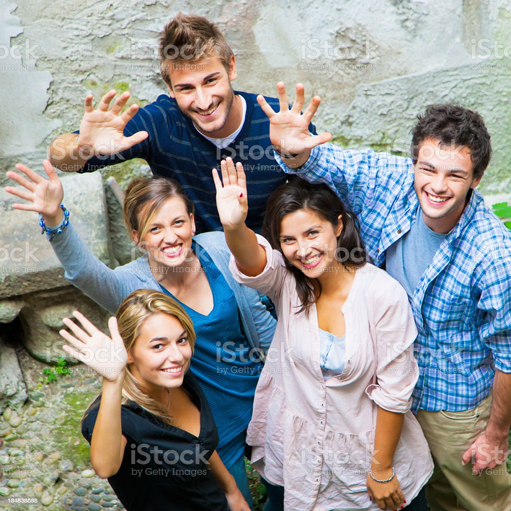 Friends waving hands together to welcome stock photo
