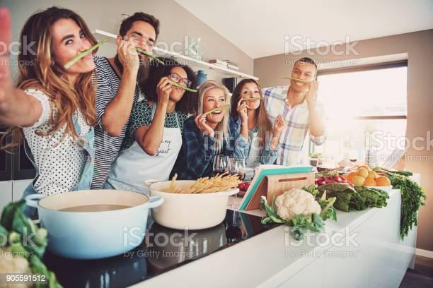 Friends wearing asparagus stalks under their noses picture id905591512?b=1&k=6&m=905591512&s=612x612&h=fffontqw8gmy4gkboo 7hdx4n sbmggalmyr7n8fhjq=