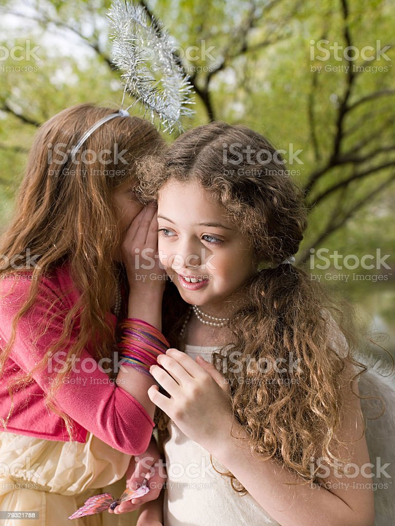 Friends whispering to each other 免版稅 stock photo