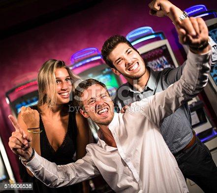 istock friends winning at slot machine 516606538