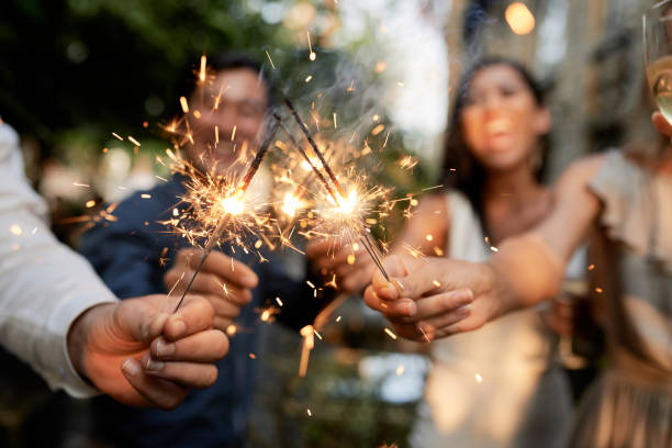 friends with burning sparklers - sparkler stock pictures, royalty-free photos & images