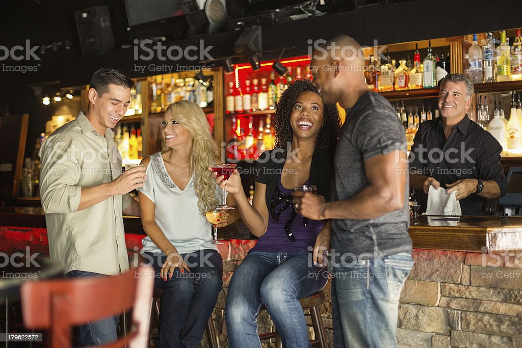 Friends With Cocktail Glasses Enjoying In Bar royalty-free stock photo