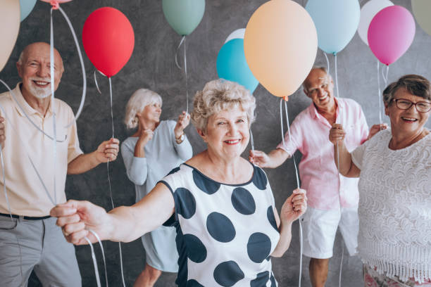 Friends with colorful balloons stock photo