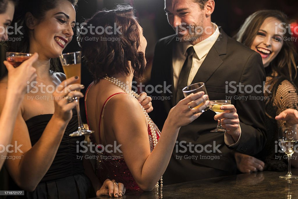 Friends With Drinks At Bar Counter. stock photo
