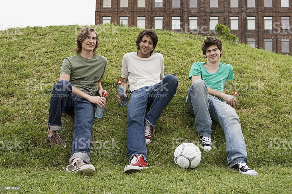 Friends with football stock photo