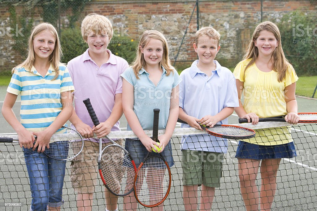 Friends with rackets on tennis court royalty-free stock photo