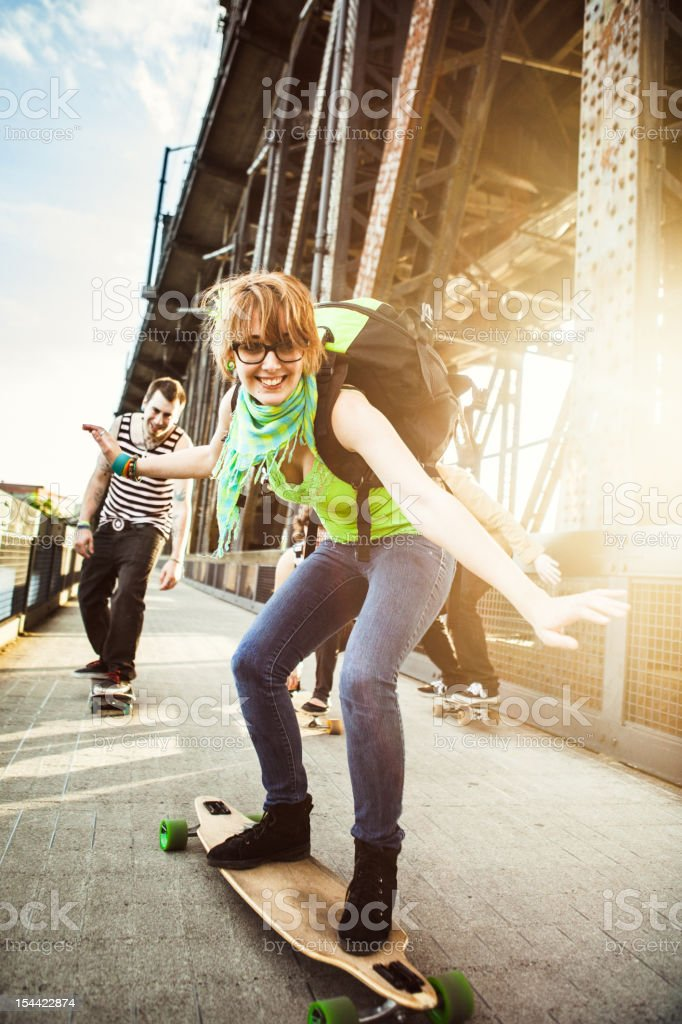 Friends with Skateboards Having Fun stock photo