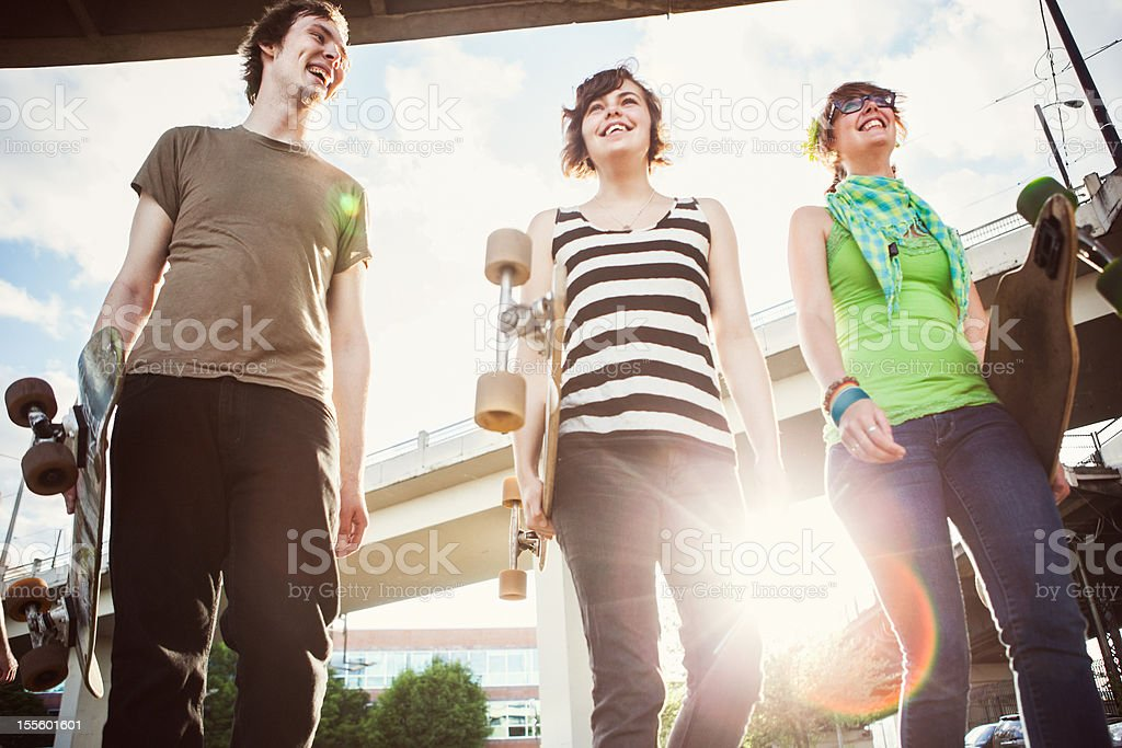 Friends with Skateboards Having Fun royalty-free stock photo