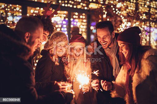istock Friends With Sparklers At The New Year Party 892366948